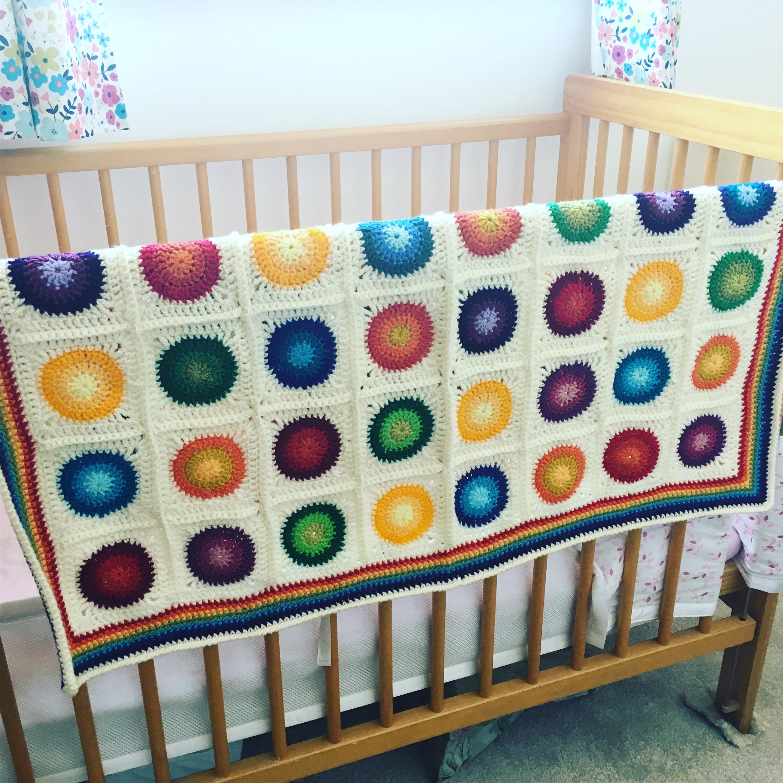 Rainbow circles acrylic cot blanket